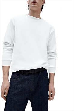 This image displays model wearing textured white sweatshirt.