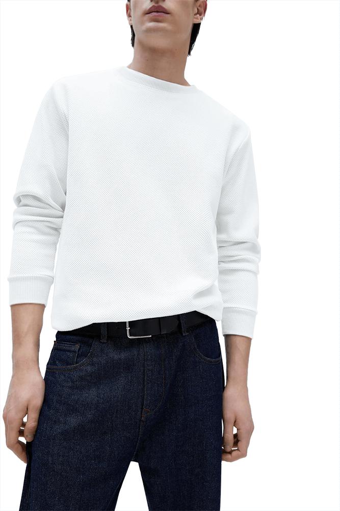 This image displays model wearing textured white sweatshirt.